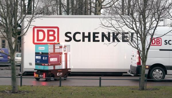 LMAD robot meetup with DB Schenker delivery van