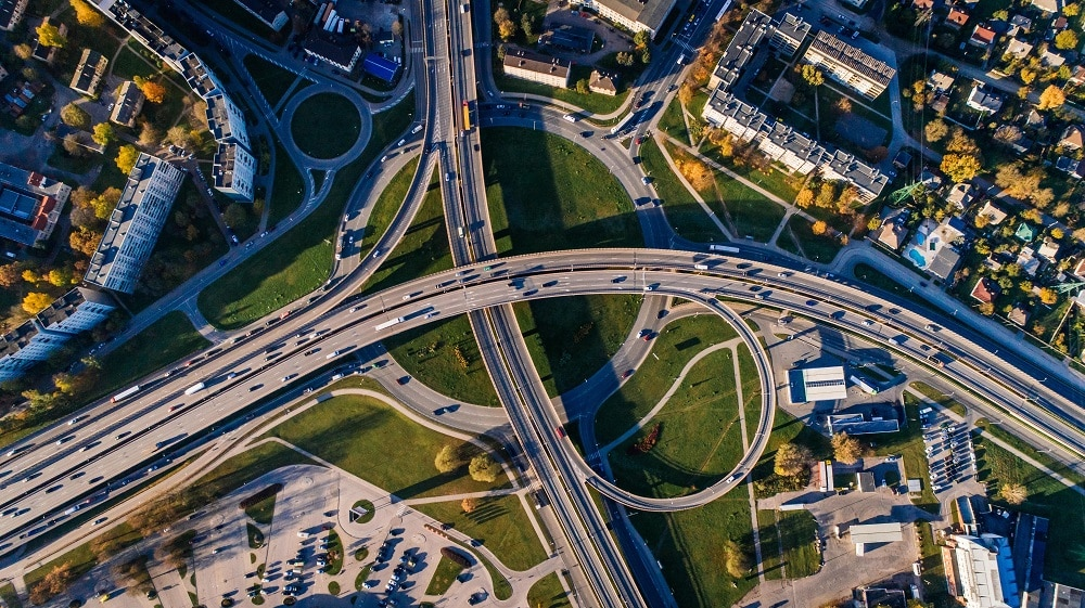 An aerial view of a complex urban environment: traffic and interconnecting roads