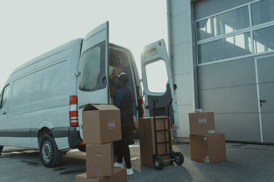 A man unloading a delivery van